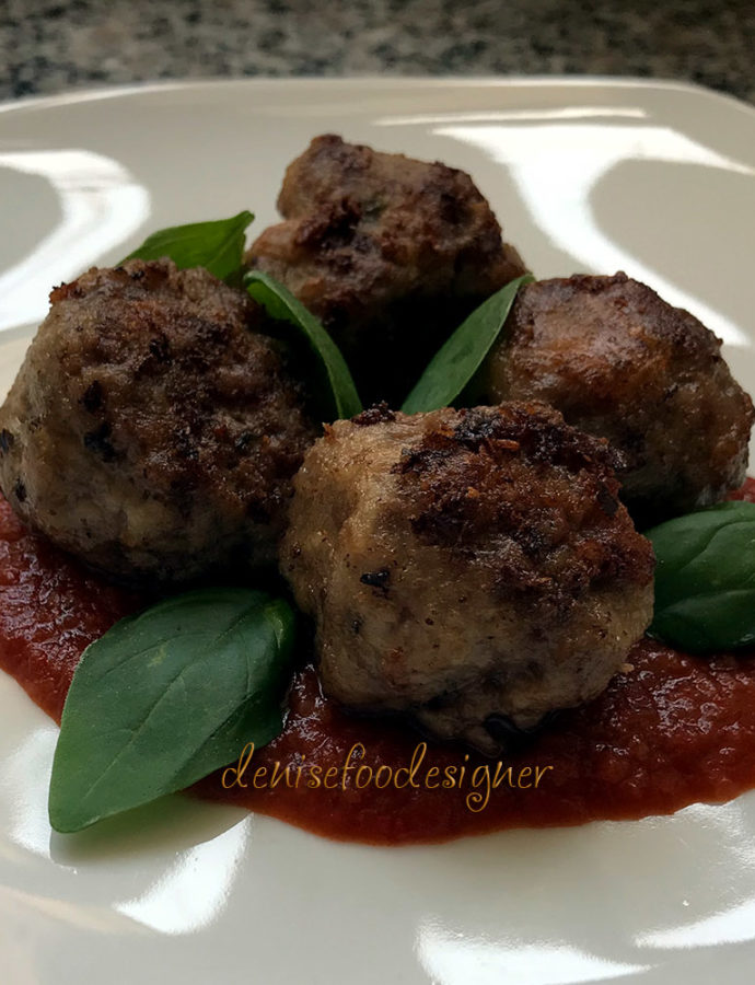 BEEF MEATBALLS BLENDED WITH BEER ON BLACK TOMATO SAUCE